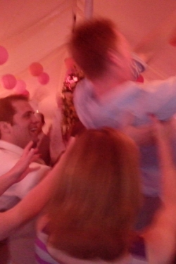 Crowd Surfing Groom at Firle Place, Sussex